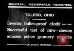 Image of bullet proof cloth test Toledo Ohio USA, 1932, second 4 stock footage video 65675030579