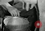 Image of milk barrels Saint Clairsville Ohio USA, 1940, second 9 stock footage video 65675030600