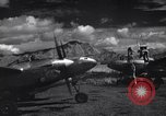 Image of P-38 planes and ground crews of 80th Fighter Squadron Port Moresby New Guinea, 1944, second 6 stock footage video 65675030623