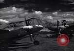 Image of P-38 planes and ground crews of 80th Fighter Squadron Port Moresby New Guinea, 1944, second 8 stock footage video 65675030623