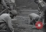 Image of TNT charges South Korea, 1950, second 12 stock footage video 65675030822