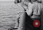 Image of Elderly Italian civilian on US destroyer Salerno Italy, 1943, second 10 stock footage video 65675030927