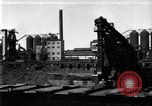Image of Unloading ore at Ford plant Dearborn Michigan USA, 1929, second 1 stock footage video 65675030994