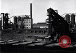 Image of Unloading ore at Ford plant Dearborn Michigan USA, 1929, second 2 stock footage video 65675030994
