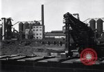 Image of Unloading ore at Ford plant Dearborn Michigan USA, 1929, second 3 stock footage video 65675030994