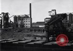 Image of Unloading ore at Ford plant Dearborn Michigan USA, 1929, second 9 stock footage video 65675030994