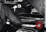 Image of Affixing car frame to chassis Dearborn Michigan USA, 1937, second 8 stock footage video 65675031007