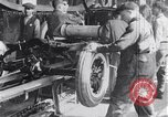 Image of Ford Motor Company assembly line Highland Park Michigan USA, 1917, second 4 stock footage video 65675031026