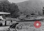 Image of road side camping United States USA, 1917, second 4 stock footage video 65675031042