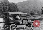 Image of road side camping United States USA, 1917, second 5 stock footage video 65675031042