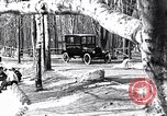 Image of Ford Model-T near icy pond United States USA, 1917, second 2 stock footage video 65675031043