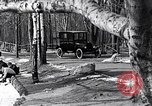 Image of Ford Model-T near icy pond United States USA, 1917, second 5 stock footage video 65675031043