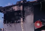 Image of USS Enterprise docked after fire Pearl Harbor Hawaii USA, 1969, second 4 stock footage video 65675031057