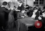 Image of Jewish refugees learn sewing Paris France, 1938, second 4 stock footage video 65675031081