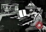 Image of Jazz great Duke Ellington plays piano New York City USA, 1943, second 6 stock footage video 65675031232