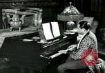 Image of Jazz great Duke Ellington plays piano New York City USA, 1943, second 8 stock footage video 65675031232