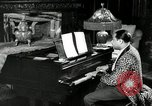 Image of Jazz great Duke Ellington plays piano New York City USA, 1943, second 9 stock footage video 65675031232