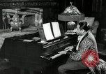 Image of Jazz great Duke Ellington plays piano New York City USA, 1943, second 11 stock footage video 65675031232