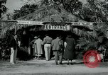 Image of tourists at Seminole Native American Indian trading post Miami Florida USA, 1936, second 4 stock footage video 65675031908