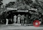 Image of tourists at Seminole Native American Indian trading post Miami Florida USA, 1936, second 6 stock footage video 65675031908