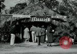 Image of tourists at Seminole Native American Indian trading post Miami Florida USA, 1936, second 7 stock footage video 65675031908