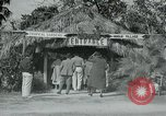 Image of tourists at Seminole Native American Indian trading post Miami Florida USA, 1936, second 10 stock footage video 65675031908