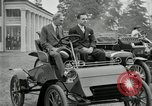 Image of Henry Ford and son, Edsel Ford pose in early model cars Dearborn Michigan USA, 1933, second 3 stock footage video 65675032016