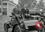 Image of Henry Ford and son, Edsel Ford pose in early model cars Dearborn Michigan USA, 1933, second 6 stock footage video 65675032016