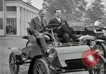 Image of Henry Ford and son, Edsel Ford pose in early model cars Dearborn Michigan USA, 1933, second 7 stock footage video 65675032016