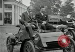 Image of Henry Ford and son, Edsel Ford pose in early model cars Dearborn Michigan USA, 1933, second 10 stock footage video 65675032016