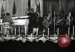 Image of Count Basie and Orchestra at Paul Robeson birthday party New York City USA, 1944, second 16 stock footage video 65675032041