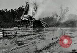 Image of oil drilling derrick United States USA, 1940, second 8 stock footage video 65675032168