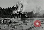 Image of oil drilling derrick United States USA, 1940, second 9 stock footage video 65675032168