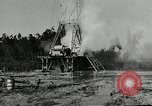 Image of oil drilling derrick United States USA, 1940, second 10 stock footage video 65675032168
