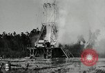Image of oil drilling derrick United States USA, 1940, second 11 stock footage video 65675032168