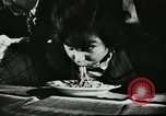 Image of spaghetti eating competition United States USA, 1950, second 6 stock footage video 65675032172