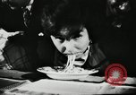 Image of spaghetti eating competition United States USA, 1950, second 7 stock footage video 65675032172