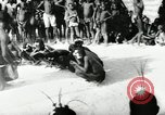 Image of ceremonial dance Africa, 1950, second 2 stock footage video 65675032183
