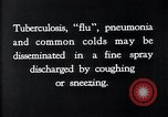 Image of disease causing bacteria sneezing or coughing United States, 1922, second 2 stock footage video 65675032296