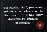 Image of disease causing bacteria sneezing or coughing United States, 1922, second 3 stock footage video 65675032296