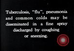 Image of disease causing bacteria sneezing or coughing United States, 1922, second 6 stock footage video 65675032296