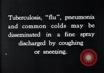 Image of disease causing bacteria sneezing or coughing United States, 1922, second 7 stock footage video 65675032296
