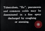 Image of disease causing bacteria sneezing or coughing United States, 1922, second 8 stock footage video 65675032296