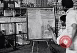 Image of artist painting on terrace New York City USA, 1937, second 1 stock footage video 65675032301