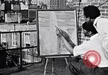 Image of artist painting on terrace New York City USA, 1937, second 2 stock footage video 65675032301