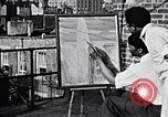 Image of artist painting on terrace New York City USA, 1937, second 3 stock footage video 65675032301