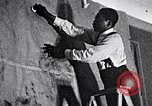 Image of Aaron Douglas and large painting New York City USA, 1937, second 10 stock footage video 65675032306