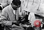 Image of Aaron Douglas painting in a museum New York City USA, 1937, second 7 stock footage video 65675032307