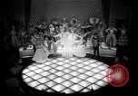 Image of dancers in night club Paris France, 1956, second 2 stock footage video 65675032323