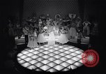 Image of dancers in night club Paris France, 1956, second 8 stock footage video 65675032323